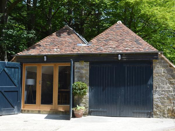 Coach house, annexe to Sussex country house and 2 dogs