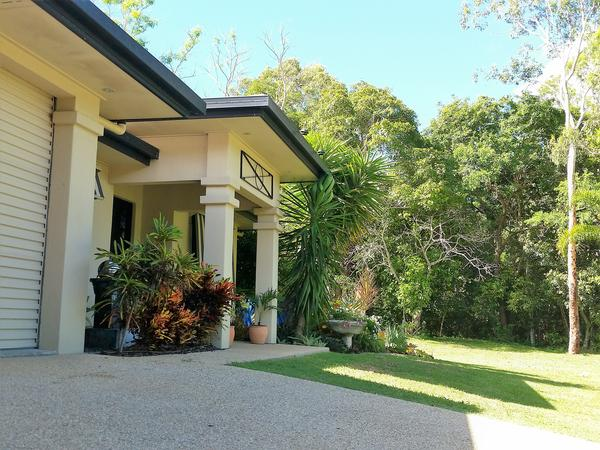 DUE TO A MEDICAL EMERGENCY WITH OUR HOUSE-SITTER WE ARE RE-ADVERTISING: Enjoy some time in our tropical paradise! No pets... but looking for garden-lovers.